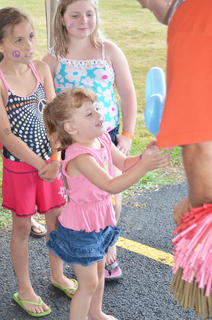 Stephanie McQueary, 3, of Campbellsville, smiles as she gets a butterfly balloon animal.