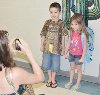 Taylor County Elementary School students went back to school on Tuesday after summer break. They were met by a new leader, interim principal Donna Williams. Matthew Newton poses for a photo with his sister, Autumn Newton, before he starts his first day of kindergarten. Autumn is a head start student.