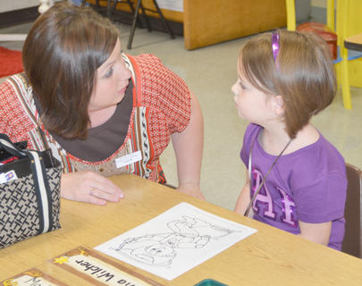 Kindergarten student Olivia Wilcher says goodbye to her mother, Kristi, as school starts.