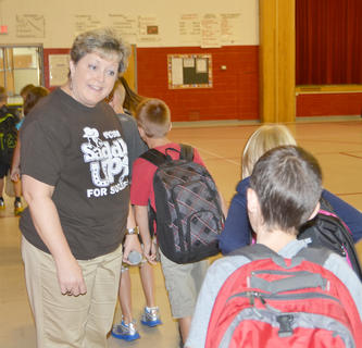 Donna Williams greets her new students as they head to class.