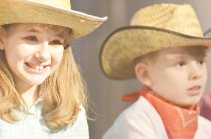 Kaylee Reynolds portrays a cowgirl and Billy Mattingly is a cowboy.