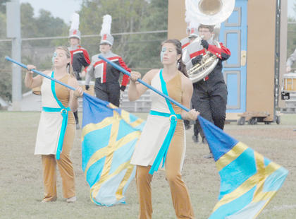Thirteen area bands competed at the annual Taylor County Marching Invitational on Saturday at Taylor County High School. April Biggs and Allison Miller are members of the TCHS color guard.