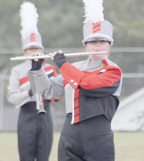 Thirteen area bands competed at the annual Taylor County Marching Invitational on Saturday at Taylor County High School. Kim Bailey plays flute for the TCHS band.