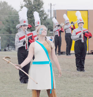 Thirteen area bands competed at the annual Taylor County Marching Invitational on Saturday at Taylor County High School. TCHS color guard member Makayla Mardis performs.