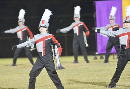 Baritone player Austin Evans and Mackenzie Despain, clarinet, march with their fellow TCHS band members.