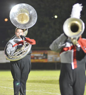 Tuba player Chris Wilson marches with the TCHS band.