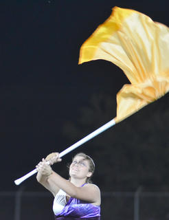 Color guard member Georgia Childers performs with the TCHS band.