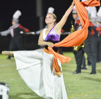 Color guard member Makayla Mardis performs with the TCHS band.
