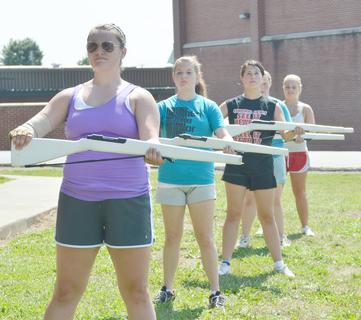 TCHS guard members practice marching with rifles during band camp on Tuesday. From left are Georgia Childers, Madison Bishop, Allison Miller, Brookylan Cox and Makayla Mardis.