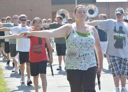 TCHS marching band members, led by clarinet player Brianna Handy, practice a drill during camp on Tuesday.