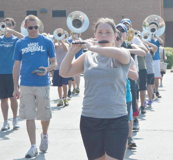 Staff member Austin Gilliatt, at left, helps TCHS marching band members, led by piccolo player Sara Beth Matney, during a drill at camp on Tuesday.