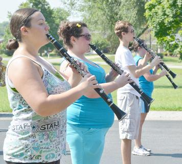 From left, TCHS clarinet players Brianna Handy, Alex Brockman, Patrick Howell and Mackenzie Despain play during a drill at band camp on Tuesday.
