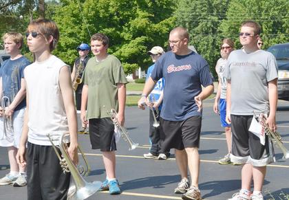 TCHS Band director Stephen Bishop, center, instructs his marching band members on how to perform a drill at band camp on Tuesday.