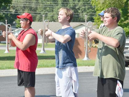 Trumpet players, from left, Zach Lawson, Cody Morgan and Chase Craig march a drill at TCHS band camp on Tuesday.