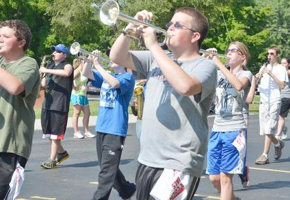 Jacob Coomer and his fellow TCHS trumpet players march a drill on Tuesday during band camp.