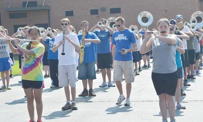 Taylor County High School marching band members practice fundamentals at band camp on Tuesday. At center is band staff member Austin Gilliatt. Band camp was July 16-20.