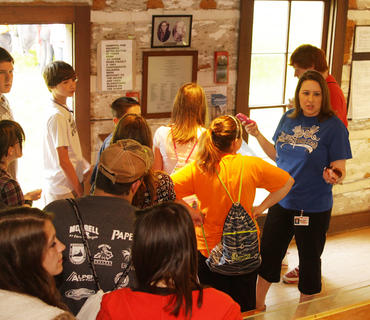 Jessica McCubbin, right, a teacher in the Taylor County School District, talks to her students during a tour of the Atkinson-Griffin House Friday, April 20.