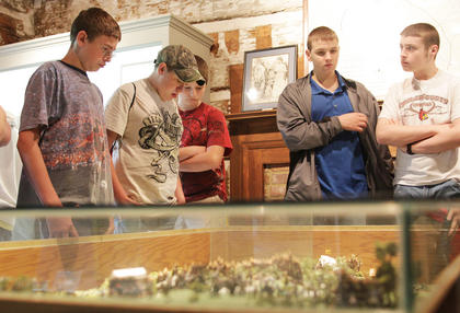 Students look at a model of the Tebbs Bend Battlefield inside the Atkinson-Griffin House.