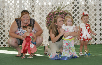 Winners of the Miss and Mister Toddler Taylor County Fair pageant are, in the girls 1-year-old girl category, from left, first runner-up Harlee Jayde Sapp, winner Adelyn Jade McMinoway and second runner-up Aubri Dobson.