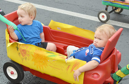 Children from Wise Beginnings take a ride in the children's parade.
