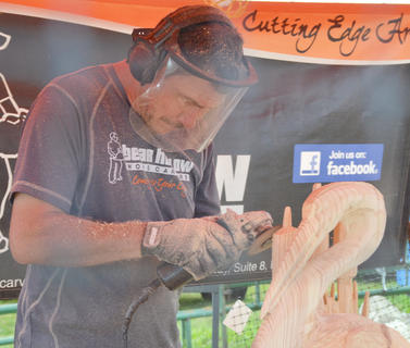 Mark Colp of California carves a wood sculpture at the fair. Colp came to the fair with the Bear Hollow Wood Carver group.