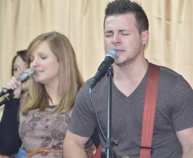 Contemporary praise and worship band NorthBound, whose members are from Russell Springs and Columbia, performs a song. From left are members Leah Franklin and her husband, Matt. The band's performance was part of youth night.