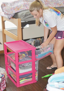 Aleesha Ailiff of Frankfort organizes her clothing in her dorm room at CU's new village.