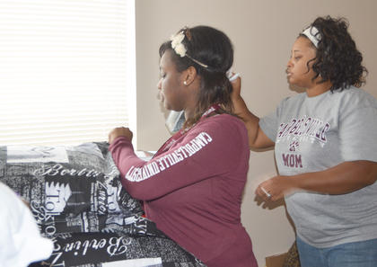 DeAnna Davison of Radcliff organizes her bedding, with help from her mother, Emma.
