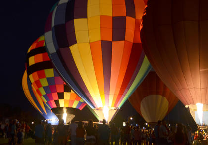 Ten hot air balloonists came to Campbellsville on Thursday night for the annual hot air balloon glow at Taylor County schools. Residents gathered to watch as the balloonists inflated their balloons and lit them up in the night sky.