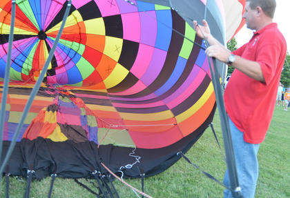 Roy McCarol of Campbellsville helps inflate a hot air balloon at the balloon glow.