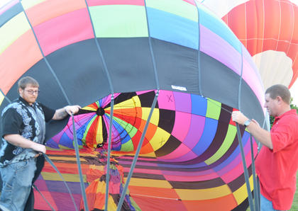 William Rice, at left, and Roy McCarol, both of Campbellsville, help inflate a hot air balloon at the hot air balloon glow.