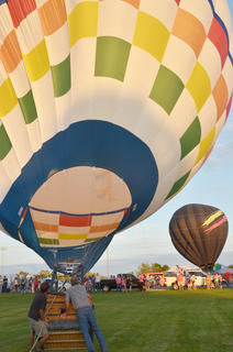 Ten hot air balloonists came to Campbellsville on Thursday night for the annual hot air balloon glow at Taylor County schools. Residents gathered to watch as the balloonists inflated their balloons.