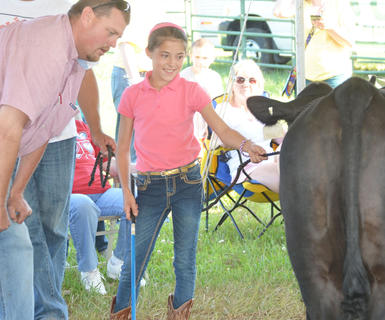 Kaylyn Smith smiles as she talks to a judge at the fair's beef show.