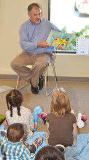 "Children listen as State Rep. John ""Bam"" Carney, R-Campbellsville, reads a book to them."