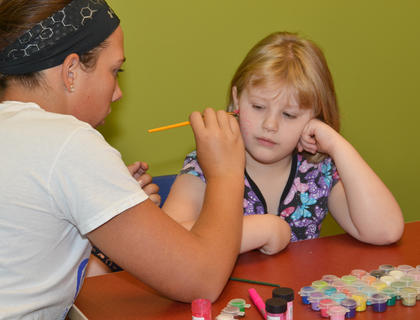 Abby Graham of Campbellsville has her face painted by Campbellsville High School Beta student Paige Dabney.