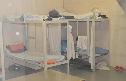 Inmates sleep on bunk beds, with their possession stored close to where they lay their head at night.