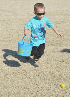 Owen Skaggs, 4, of Campbellsville, searches for eggs.