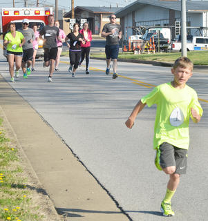Layken Lyons, 8, of Campbellsville, gets a lead on his competitors at the start of the race. Logan Dial, behind Lyons, third from left, a senior at CHS, finished first.