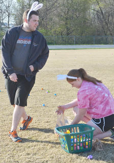 Local high school and college students hide eggs for an egg hunt after the race.
