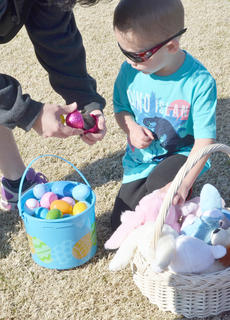 Owen Skaggs, 4, of Campbellsville, looks to see what prize he has won after finding a grand prize egg.