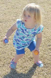 Aubrey Dial, 1 1/2, of Campbellsville, searches for eggs during an egg hunt after the race.