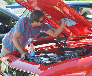 Scott Gardiner of Lebanon shines his 1967 Chevrolet Camaro at the annual Fourth of July car show on Friday morning.