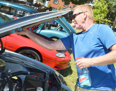 Kenny Spalding of Bardstown shines his 1968 Chevrolet Camaro at the annual Fourth of July car show on Friday morning.