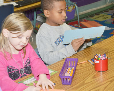 Vanessa Adkins' first-grade students at Campbellsville Elementary School learn during class last Thursday about how people from other cultures celebrate New Year's Day. Here, students make a Chinese New Year's lantern.
