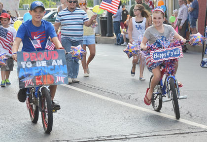 Children decorated bicycles and rode in the children's parade on Thursday night.