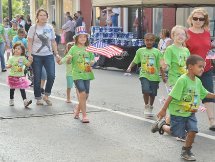 Children participating in the Taylor County Public Library's summer reading program dressed the part for the children's parade on Thursday night.
