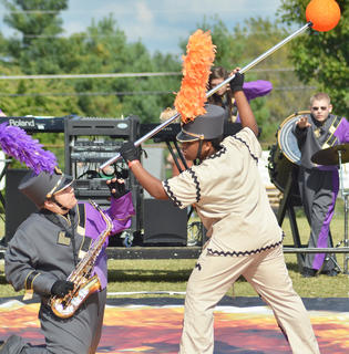 Darius Wright, at right, performs with the CHS band and strikes a final pose with saxophone player Randy Harris.