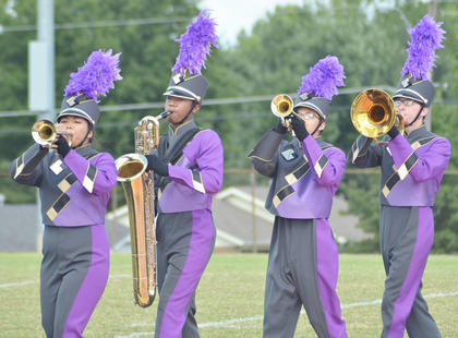 From left, CHS band members Claudia Rogers, Kalup Cowan, Nicolas Cowan and Glen Hooper perform.
