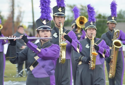 From left, Abby Hieneman, Anthony Drew, Randy Harris and Kalup Cowan perform with the CHS band.