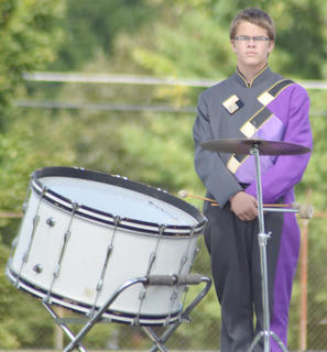 John Netherland stands at attention during the CHS band performance.